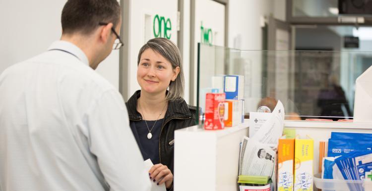 lady speaking to pharmacist