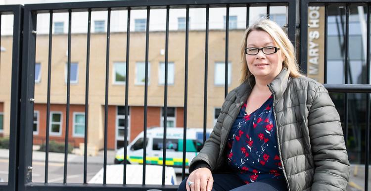 woman sitting outside hospital