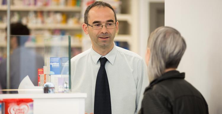 pharmacist talking to woman