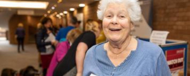 older woman standing in hallway