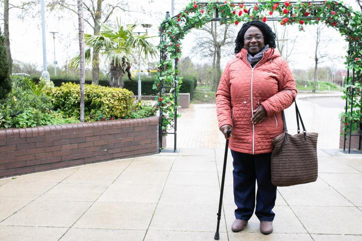 woman standing outside with walking stick