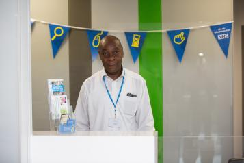man standing at reception