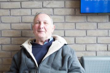 elderly man in waiting room