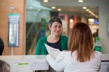 Woman speaking to a receptionist