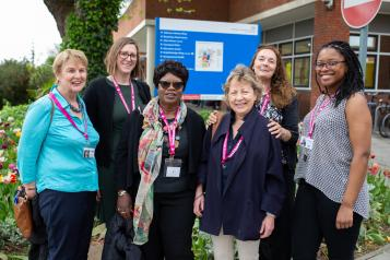 Group of women who work for Healthwatch, standing outside a hospital