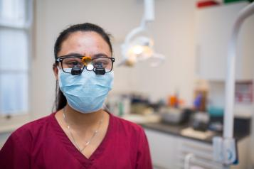 dentist wearing a mask looking at the camera