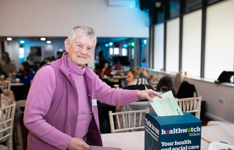 woman voting at AGM
